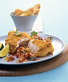 Breaded fish fillet with pepper salsa