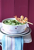 Green asparagus soup with fried prawns