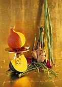 Exotic vegetable still life against gold background