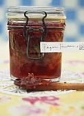 A jar of fig and grape jam