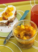 Pumpkin and physalis jam with pecans, in jar and on bread