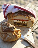 Stuffed picnic loaf with vegetable filling