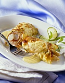 Pancake and smoked salmon rolls filled with asparagus, melted cheese