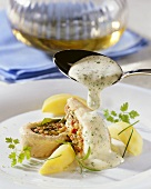 Steamed trout fillet with vegetable stuffing and herb sauce