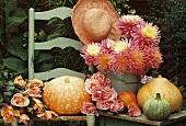 Autumn still life: pumpkins, roses and dahlias