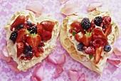 Two meringue hearts with lemon mascarpone cream and berries