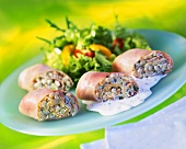 Ham rolls with barley and vegetable filling and salad leaves