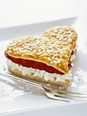 Puff pastry heart filled with strawberries and whipped cream