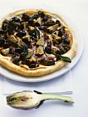 Artichoke pizza with olives, onion rings and sage