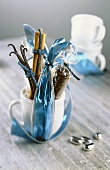 Chocolate, cinnamon and vanilla pods in cup to give as a gift