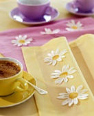 Hot chocolate on table with springtime decorations