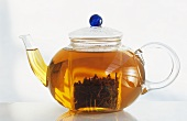 Glass teapot full of tea