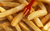 Chips with red plastic fork, full-frame