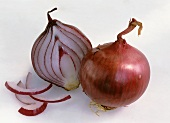 Whole red onion and half a red onion