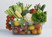 Shopping basket full of different vegetables