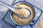 Basmati rice in Asian bowl and porcelain spoon