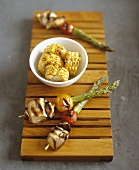 Grilled cheese and vegetable skewers with corn on the cob