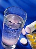 Vitamin tablets with a glass of water
