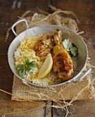Chicken leg on saffron rice