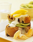 Toasted fruit bread with fruit and yoghurt for breakfast