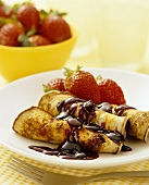 Blueberry pancakes with fresh strawberries