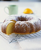 Orange semolina cake on a cake rack