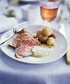 Roast lamb with potatoes and herb sauce