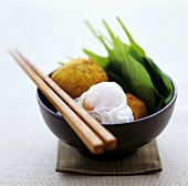 Deep-fried fish balls with poached egg