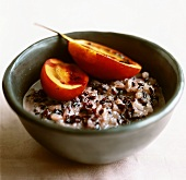 Sweet rice and sesame seeds in coconut milk with tamarillo