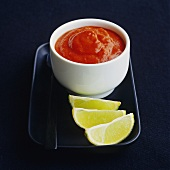Chilli sauce with lime wedges