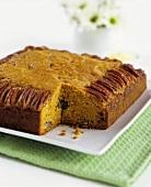 Pumpkin-pecan cake, sliced