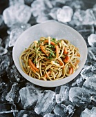 Oriental noodle salad with enokitake and ice cubes
