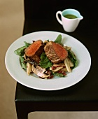 Beef fillet on a spinach salad with mushrooms