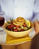 Vegetable salad with sausages and fried calamari