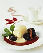 Christmas dumpling with vanilla sauce and plums