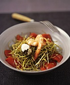 Prawns and quails' eggs with leek straw on a bed of red peppers