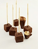 Cubes of drinking chocolate and chocolate cups