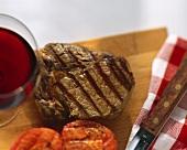 A grilled ribeye steak, cut open
