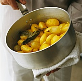 Cooked potatoes with shallots, saffron and bay leaves