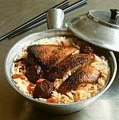 Grilled duck on a bed of rice
