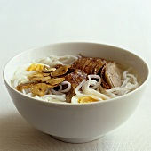 Oriental noodle soup with duck and a quails' egg