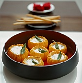 Baked mini pumpkins stuffed with cheese and sage