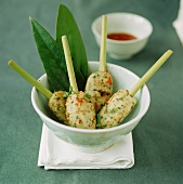 Fish balls on lemon grass skewers