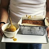 Sticky toffee pudding with caramel sauce on a tray