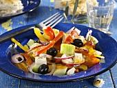 Greek salad on a glass plate
