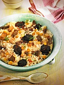 Arroz al horno (oven baked rice, Spain) with morcilla, meat and chickpeas