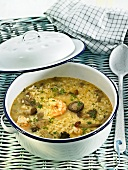 Arroz caldoso (rice soup, Spain) with prawns and mushrooms