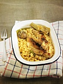 Arroz meloso (fried rice, Spain) with rabbit and artichokes