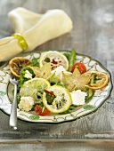 Lemon salad with star fruit and cheese