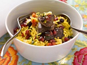 Exotic rice salad with pomegranate seeds and fried chicken liver
